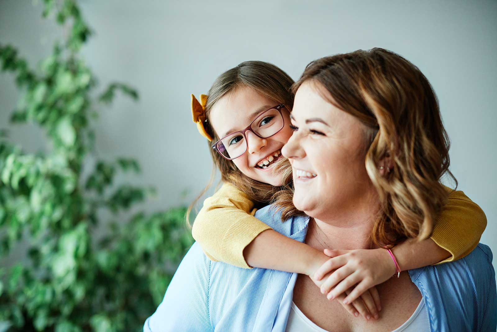 Daughter wrapping arms around mother